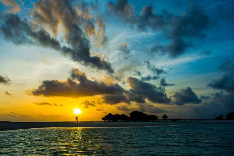 nimbus cloud and body of water